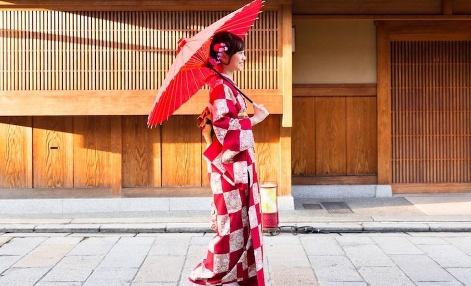 A Japanese girl holding an umbrella.