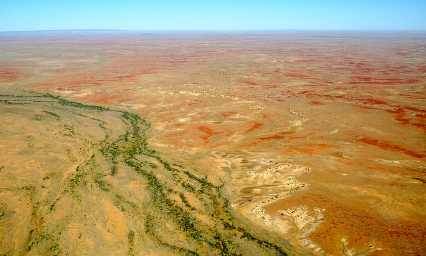 Aerial view of creeks cutting through parched outback in South Australia's far north.
