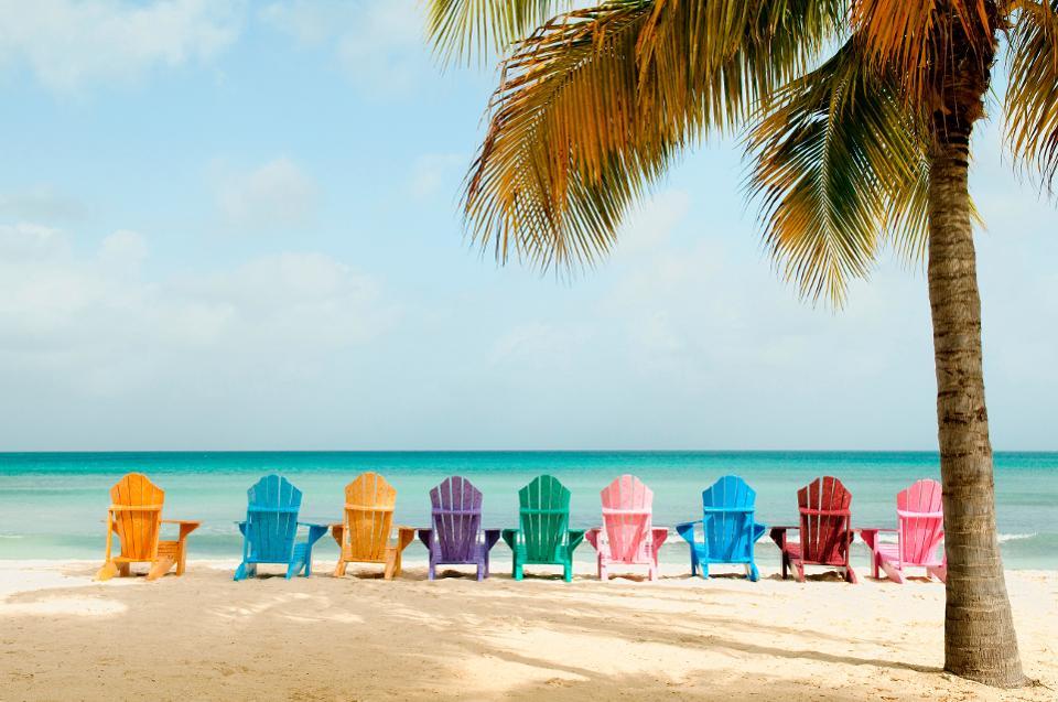 Sun loungers on beach aruba coronavirus tourism travel