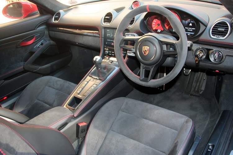 Alcantara trim and red accents liven up the interior of Cayman's top model. Picture: DENIS DROPPA