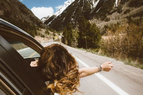young woman on road trip