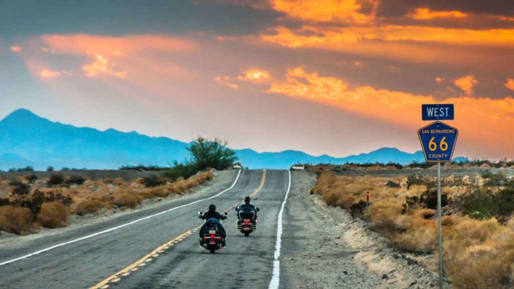 A picture containing outdoor, road, scene, motorcycle  Description automatically generated