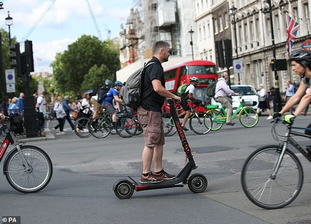 It is a particular issue with electric scooters because although they are widely used by commuters, they remain illegal on public roads, cycle lanes and pavements (file photo)