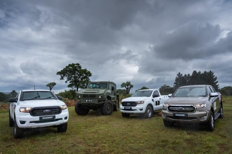 Image of 3 armour protected Ford Rangers and a armoured vehicle