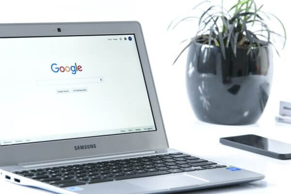 Image of a switched on laptop showing Google on the screen